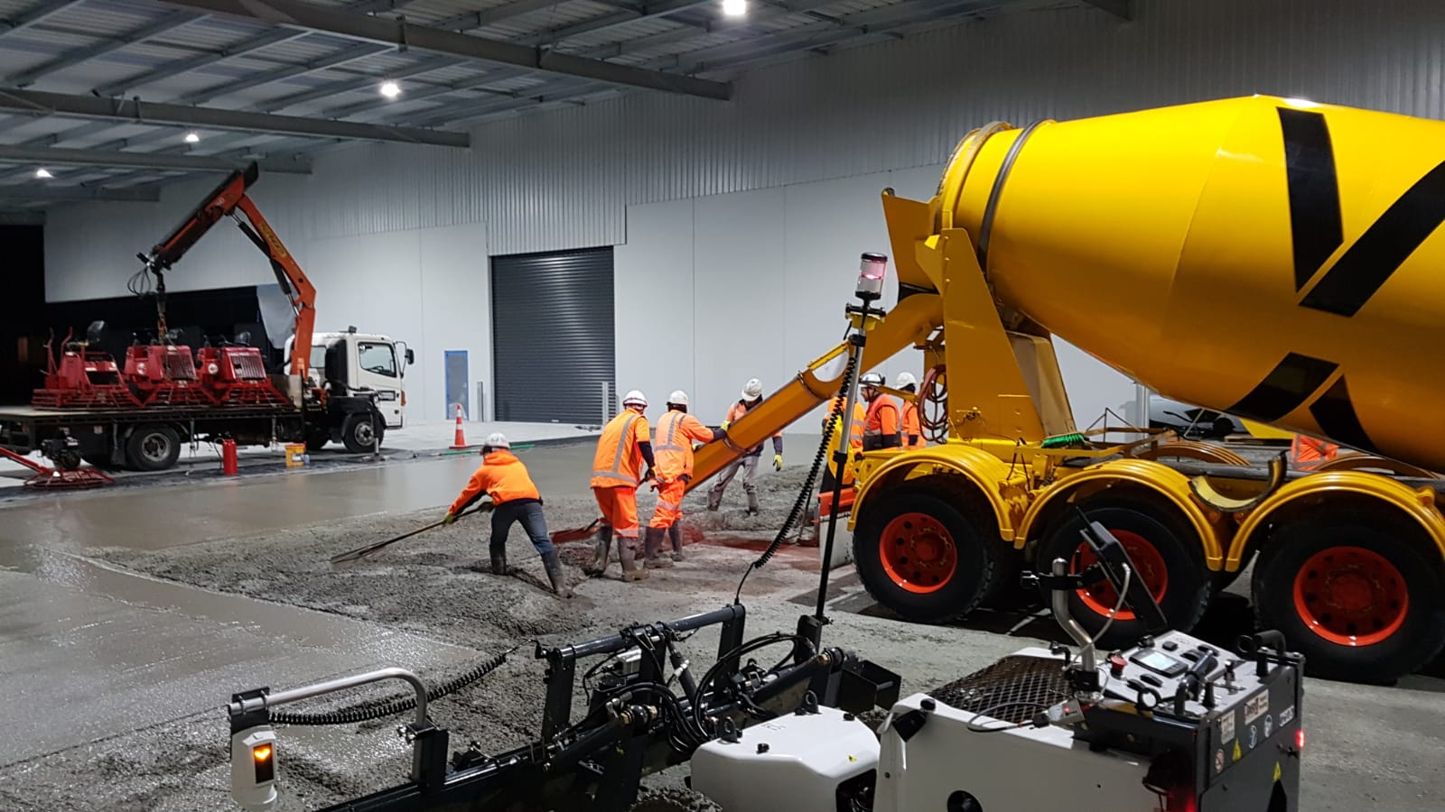 Workers pour concrete with Permaforce steel fibre reinforcing by Inforce