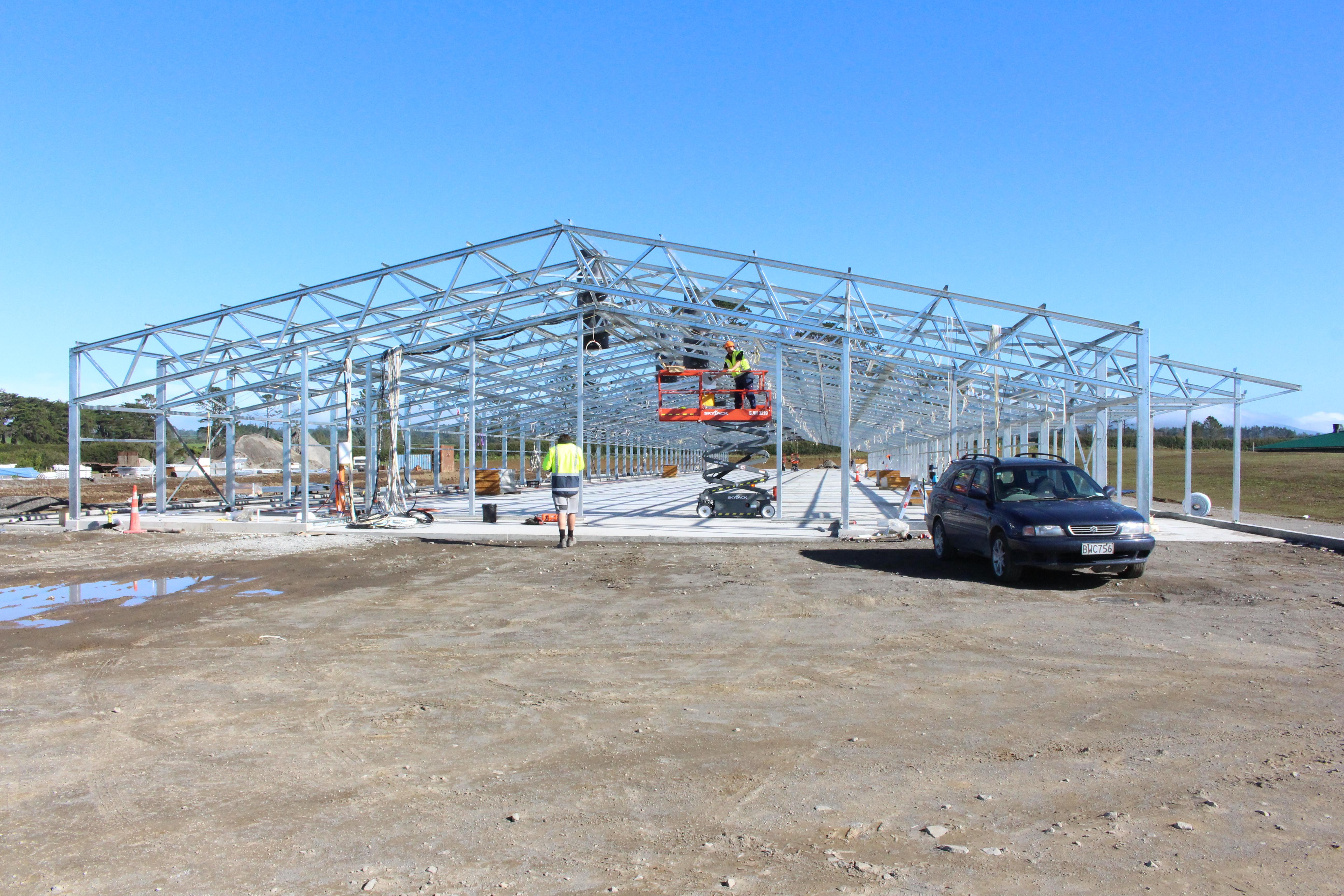 A steel building is erected over a fibre reinforced concrete foundation