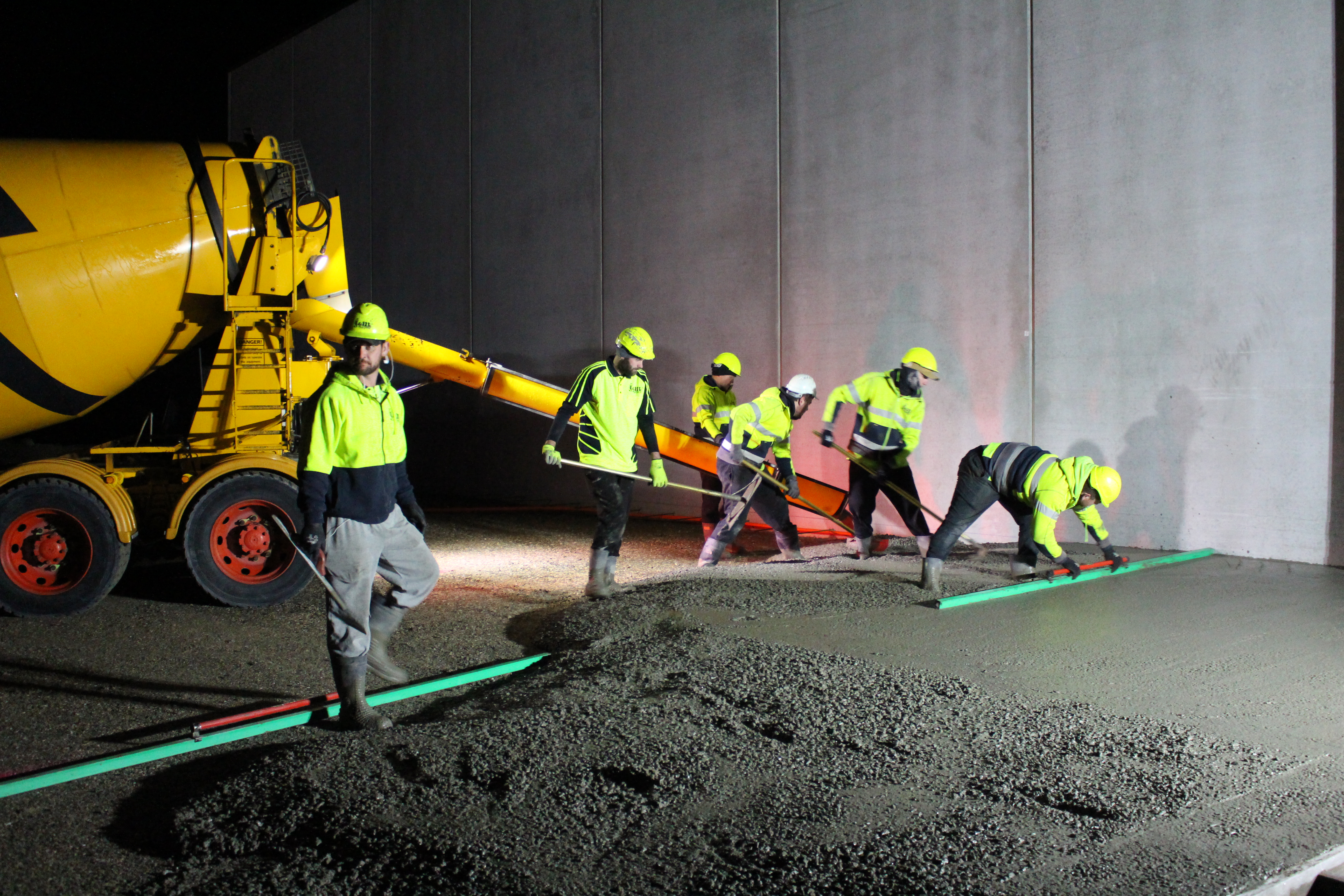 During the night, concrete placers pour prepared concrete with fibre reinforcing