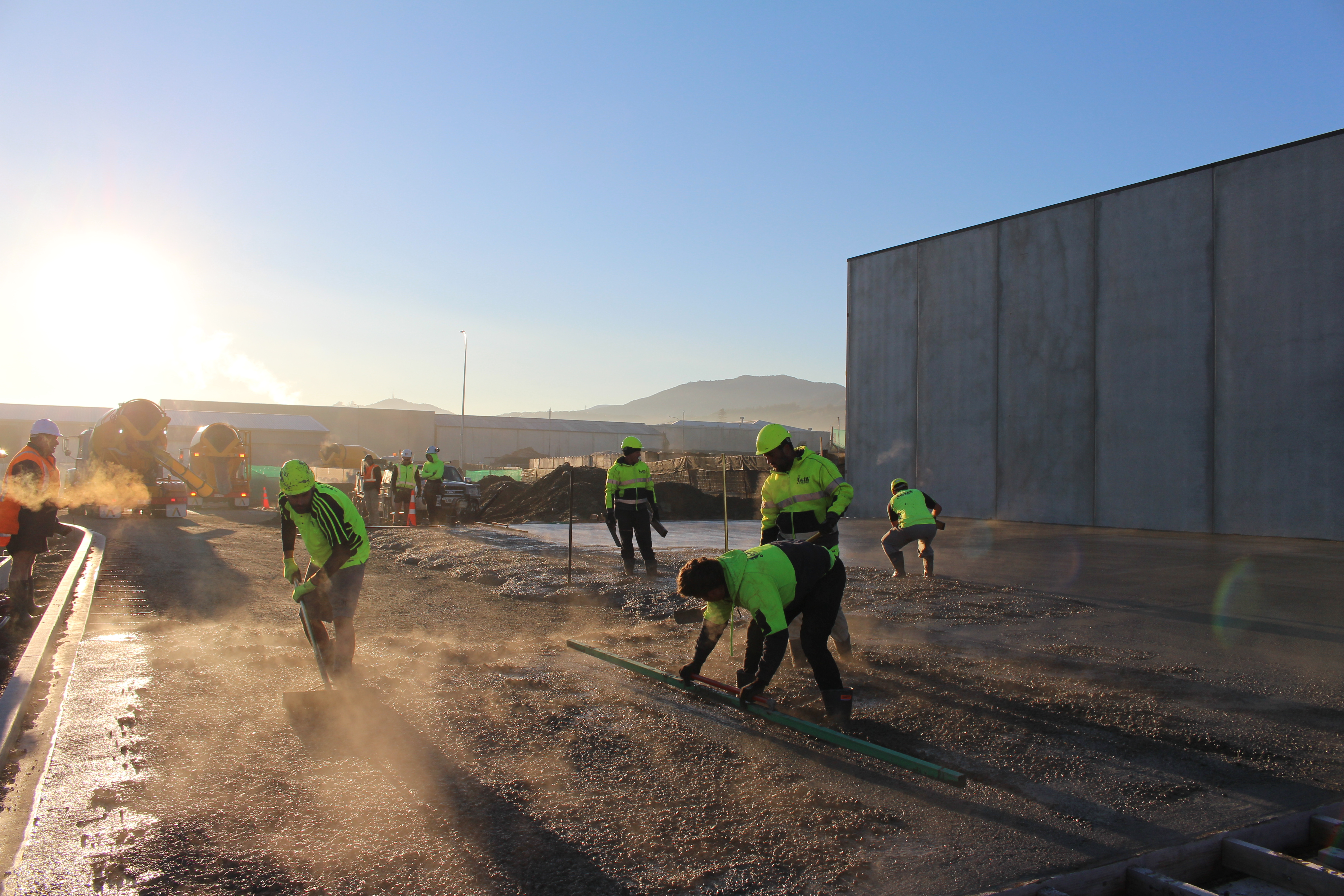Workers early in the morning preparing the base of a fibre reinforced slab saving time over the traditional methods