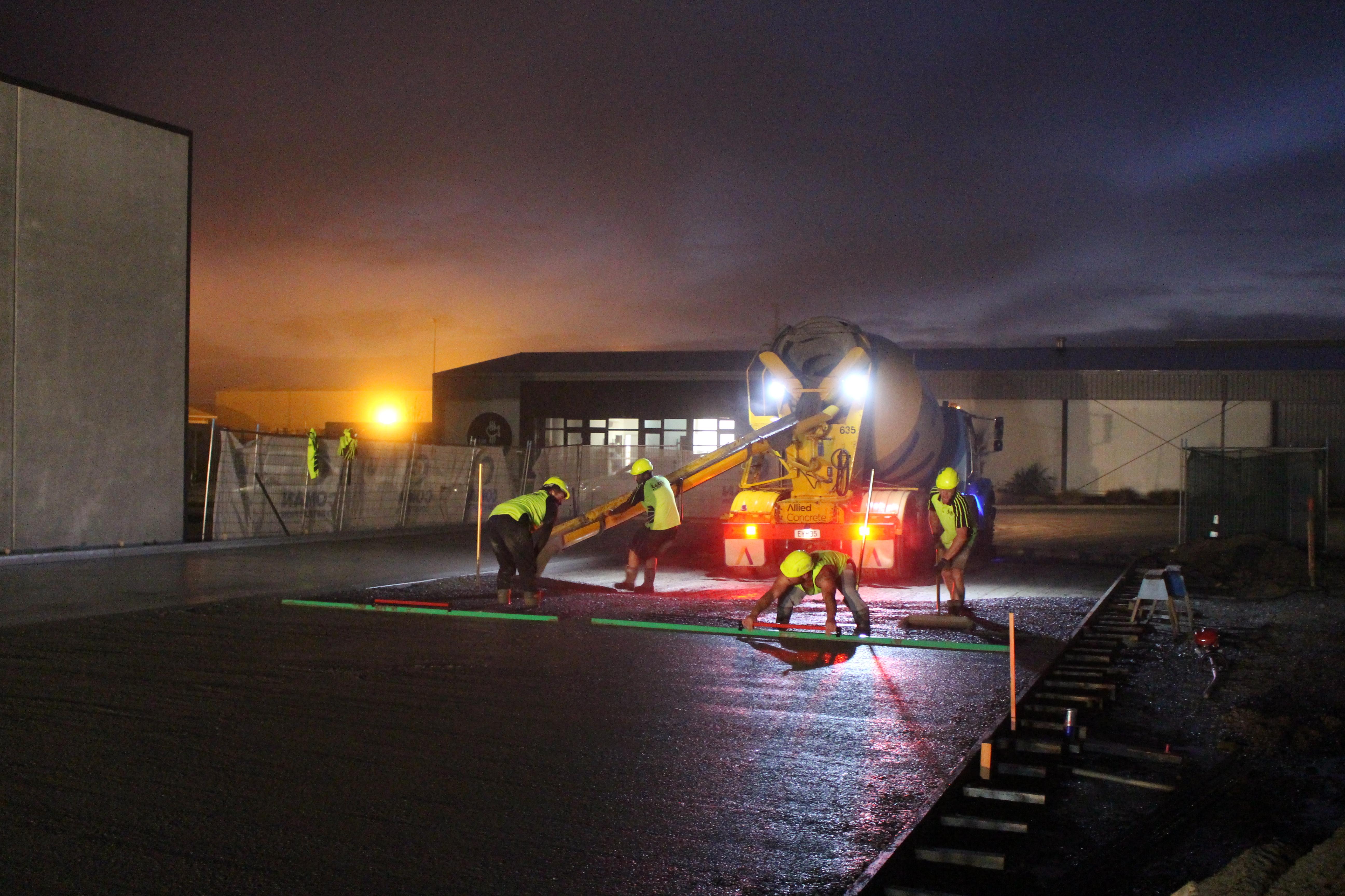Workers pour fibre concrete into place at Pics factory build Nelson