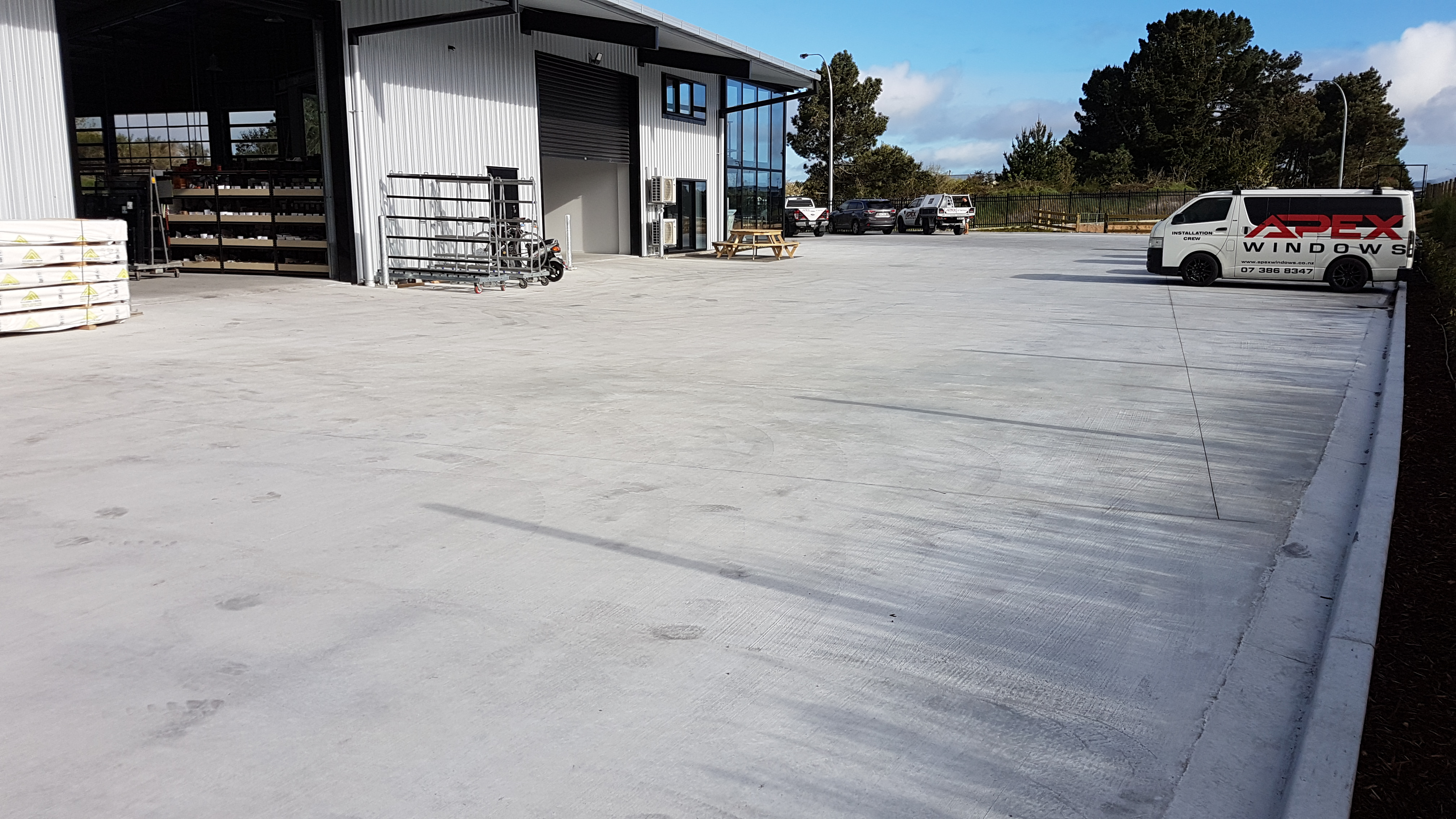 Concrete work in a commercial yard loading bay and parking zone with concrete reinforced with Inforce Proforce hookend steel fibre