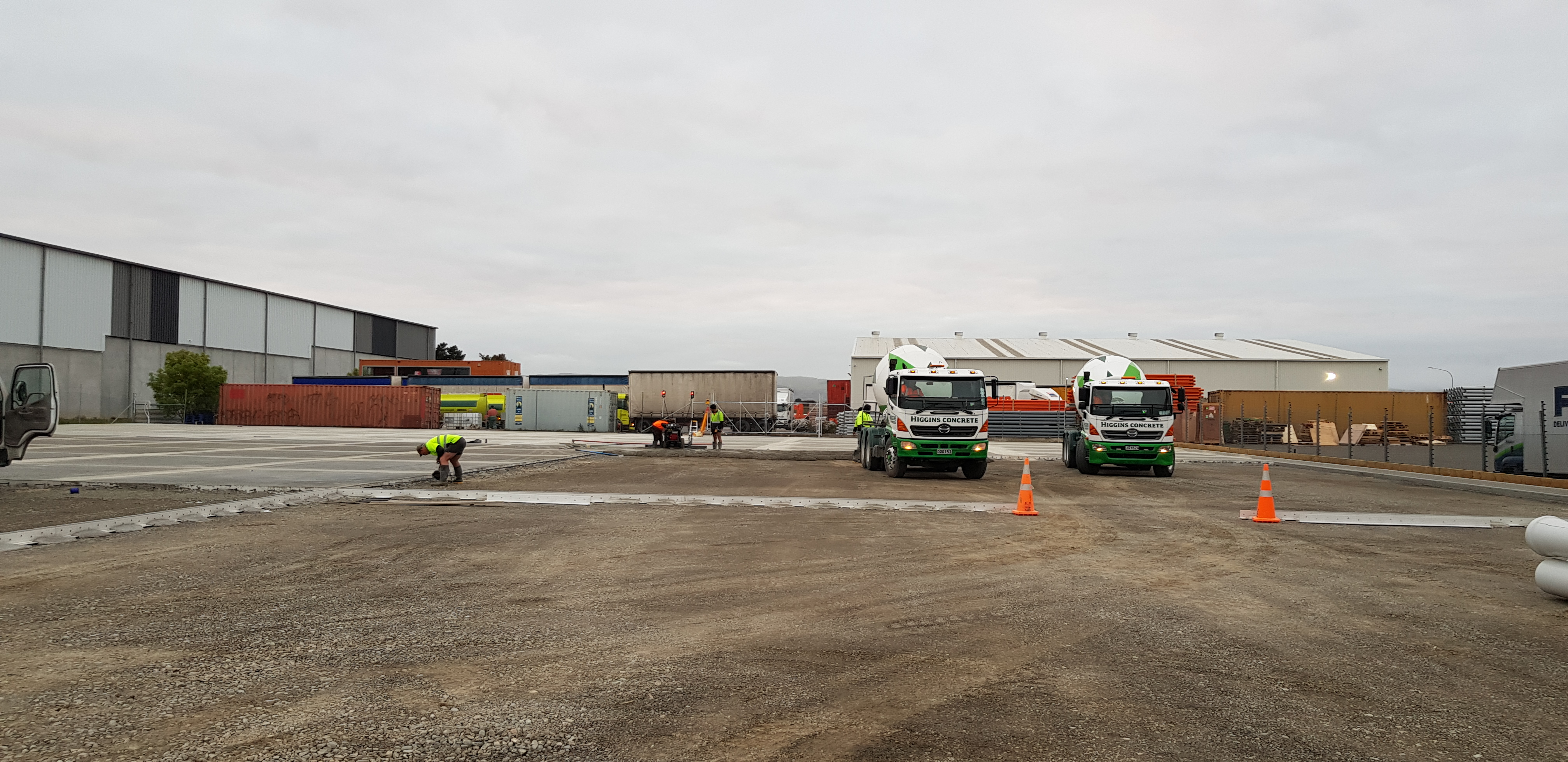 Cement trucks deliver Permaforce fibre reinforced concrete slurry to the slab site