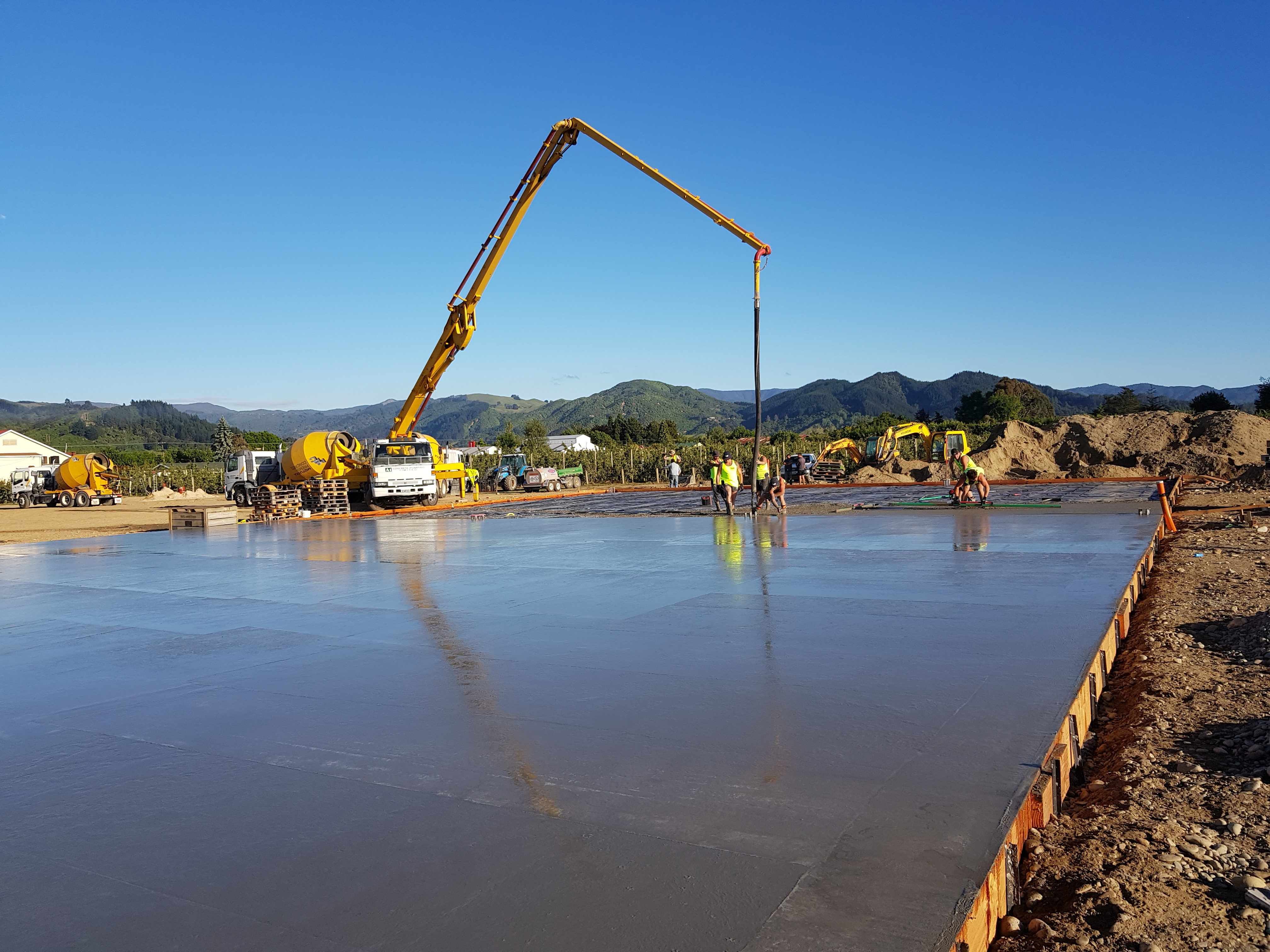 A concrete crane pours fibre cement on this coolstore slab
